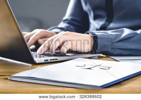 Legal Worker In Law Firm With Laptop Computer. Attorney, Prosecutor Or Solicitor Working On A Legisl