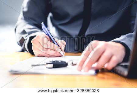Car Loan Form Or Lease Application Document. Man Signing Paper Contract To Sell Premium Vehicle. Buy