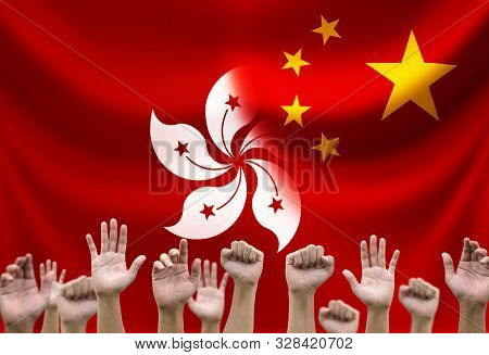 Rise Up Hand With China And Hong Kong Flags .hong Kong People Protestor Concept.