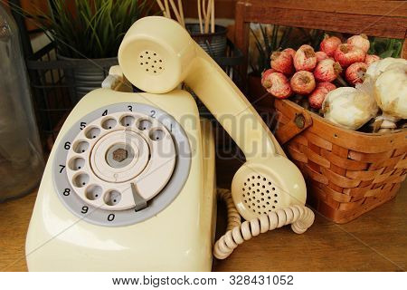 Vintage Old Telephone On Brown Wooden Table