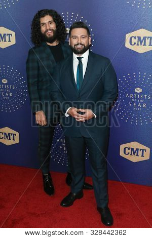 NASHVILLE, TEN - OCT 16: Dan Smyers (L) and Shay Mooney of Dan + Shay attend the 2019 CMT Artists of the Year at Schermerhorn Symphony Center on October 16, 2019 in Nashville, Tennessee.