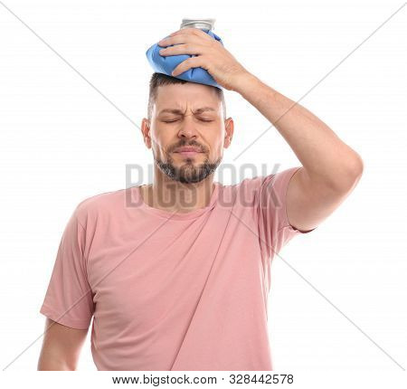 Unhappy Man Using Cold Pack To Cure Headache On White Background