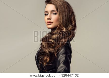 Beautiful Stylish Woman Wearing  Black Leather Jacket. Fashionable And Self-confident Girl With Long