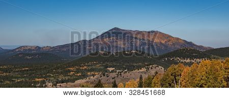 Fall Landscape With Mountain, Trees, And Bright Colors