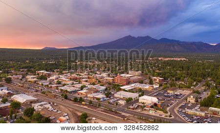 Blue And Orange Color Swirls Around In The Clouds At Sunset Over Flagstaff Arizona