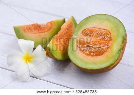 Sliced Cantaloupe Thai Tropical Fruit Asian And Flower On Wooden Background / Cantaloupe Melon Muskm