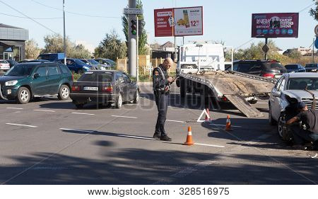 Odessa, Ukraine - October 16, 2019: Car Accident, Head-on Collision. A Tow Truck Loads A Wrecked Car
