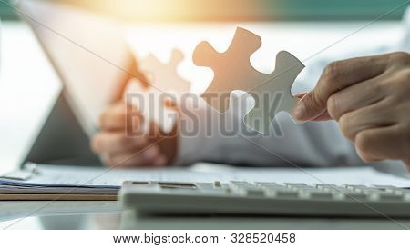 Business Solution And Strategy For Corporate Business Success Concept With Jigsaw Puzzle Pieces In B