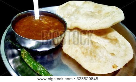 Chole Bhature: Indian Dish Spicy Chick Peas Curry Also Known As Chole Or Chana Masala Is Traditional