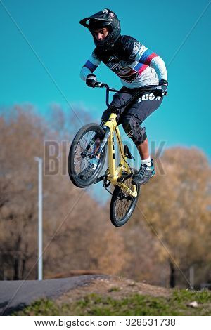 Moscow, Russia - Oct 19, 2019: Young boy jumping with his BMX Bike at pump track. BMX race. Cyclist