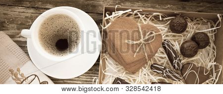 White Cup Of Coffee On A Natural Old Wooden Background With Biscuits. Selective Focus. With Copy Spa