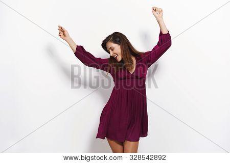 Cheerful Amused Good-looking Glamour Woman In Purple Dress Having Fun Enjoy Party Night Club, Raise