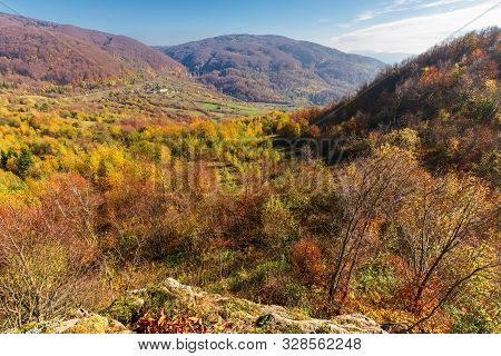Autumn Scenery In Mountains On A Sunny Day. View From A High Vantage Point In To The Distant Valley.
