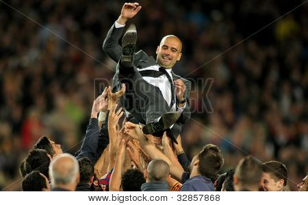BARCELONA - MAY, 5: FC Barcelona coach Guardiola is launched for his players after the Spanish league match at the Camp Nou stadium on May 5, 2012 in Barcelona, Spain
