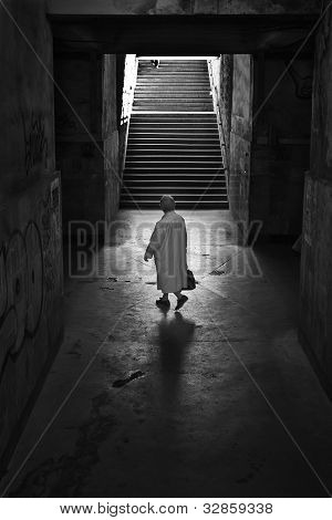 Woman passing in a tunnel
