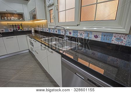 Interior design decor showing modern kitchen with cupboards and sink in luxury apartment showroom poster