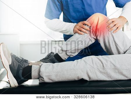 Joint, Knee And Leg Pain Treatment. Physiotherapist Exam Patients Knee Close-up