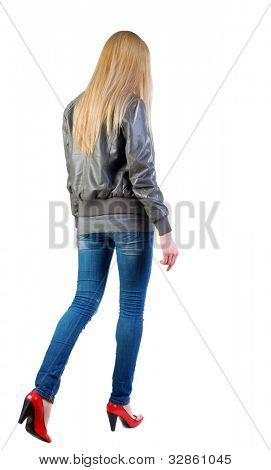 walking blonde girl in motion. during a walk.  going woman back view . Rear view people collection.  backside view of person.  Isolated over white background.