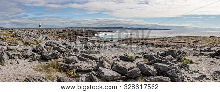 Panorama With Beach, Lighthouse  And Cliffs Of Moher In Background In Inisheer Island