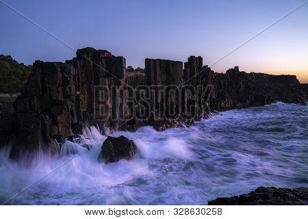 Bombo Quarry Headland, Nsw, Australia. Morning Sunrise With Sea Waves Crashing Onto The Rugged Coast