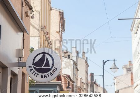 Lyon, France - July 17, 2019: Petit Bateau Logo In Front Of Their Local Store In Lyon. Petit Bateau