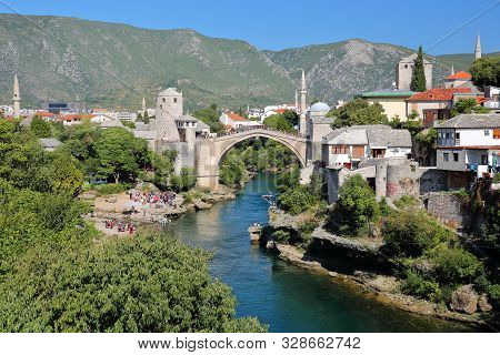 The City Of Mostar Viewed From Lucki Most Bridge, With The Old Bridge (stari Most), The Neretva Rive