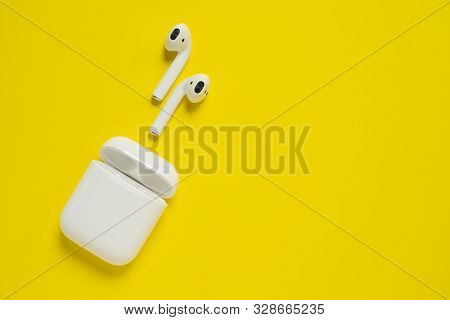 Rostov-on-don, Russia - October 07, 2019: Apple Airpods Wireless Bluetooth Headphones And Charging C