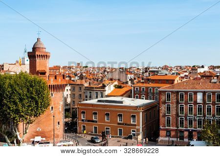 PERPIGNAN, FRANCE - SEPTEMBER 14, 2019: Aerial view of the old town of Perpignan, France, highlighting on the left Le Castillet bastion, an iconic landmark in the city, built on the fourteenth century