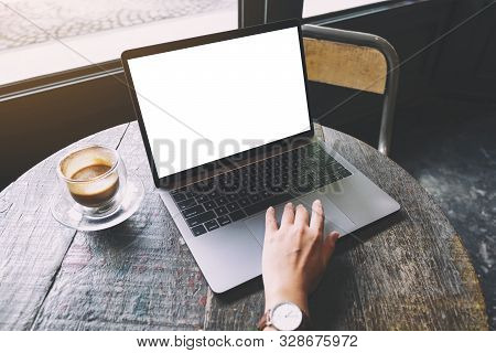 Mockup Image Of A Woman Using And Touching On Laptop Touchpad With Blank White Desktop Screen On Woo