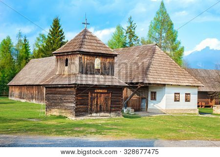 Old Traditional Houses And Wooden Belfry Of Village Pribylina In Liptov Region (slovakia) - Panorama