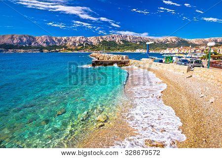 Baska. Idyllic Pebble Beach And Town Of Baska View, Island Of Krk In Kvarner Bay Of Croatia