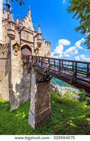Lichtenstein Castle With Wooden Bridge, Baden-wurttemberg, Germany. This Fairy Tale Castle Is A Land