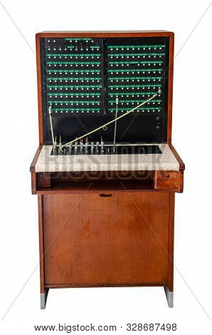 Old Telefon Switchboard In Front Of A White Wall, Isolated On White Background