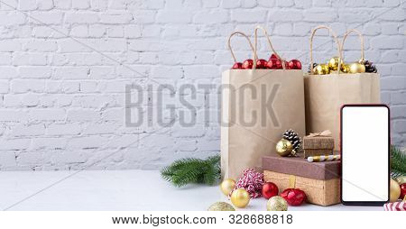 Blank Screen On Mobile, Smart Phone, Cell Phone With Christmas Decorations, Concept Of Shopping Chri