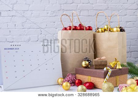 Christmas Decorations In Kraft Paper Shopping Bags And Calendar Year End, Concept Of Shopping Online