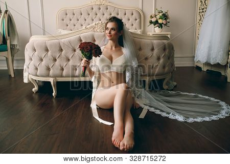 Morning Of The Bride. Beautiful Sexy Blonde Girl Posing In White Lace Underwear. Portrait Of A Beaut