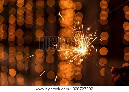 Diwali Holiday Greetings Card, Postcard. A Young Woman Holding Lighted Fireworks With Bright Golden