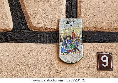 Riquewihr, France, October 13, 2019 : Address Number Plates, With Regional Symbols On The Wall. The