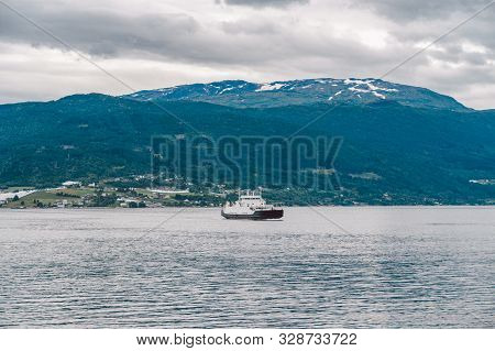 Ferry Boat Transportation Norway. White Passenger Ferry Goes On Fjord. In Norway. Ferry Crossing A F