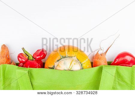 Trendy Ugly Organic Farm Vegetables With Mutations In Green Recyclable Shopping Bag On White Backgro