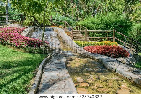 Beautifuo And Colorful Garden With Varied Vegetation.