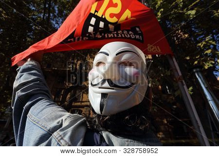 Rome, Italy - October 18, 2019: The Mask Of Anonymous In Front Of The Flag Of Asia Usb During The Ga