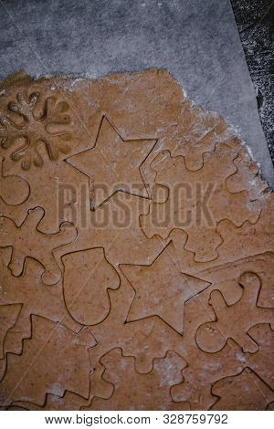 Cut Out Gingerbread Cookie In The Form Of A Christmas Tree, Star, Little Man, Hearts From Raw Dough