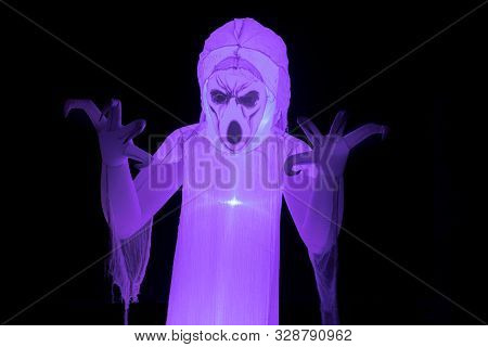 Angry Ghost Glowing In The Dark. Outdoor Décor in Halloween Season. poster