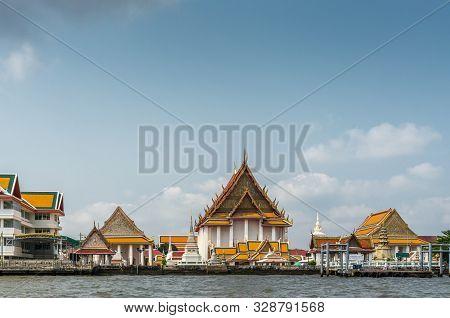 Bangkok City, Thailand - March 17, 2019: Chao Phraya River. Wat Kalayanam Worawihanwhite With Its Ta