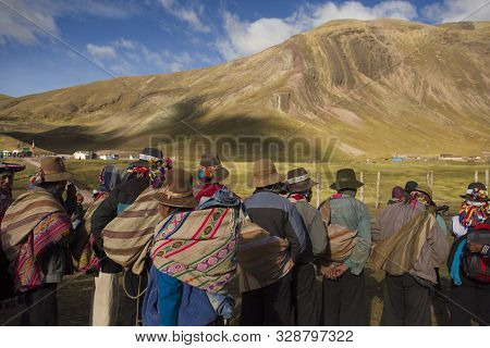 Cusipata, Peru - June 08, 2017: Traditional Peruvians In Group Waiting For Tourists To Support Them