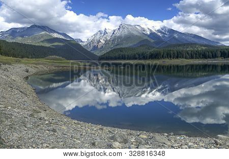 The Rocky Shoreline Of Mission Reservoir Near St. Ignatius, Montana