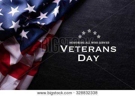Happy Veterans Day. American Flags With The Text Thank You Veterans Against A Blackboard Background.