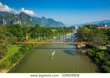 Aerial View Of Village Vang Vieng And  Nam Song River , Laos. Southeast Asia. Photo Made By Drone Fr