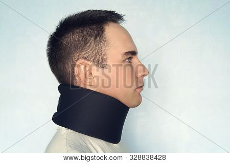 A Guy With A Bad Neck In A Black Neck Collar To Stabilize The Cervical Vertebrae. A Man With A Neck